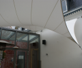 Design overkapping van zeil doek als overkapping voor rokersruimte - Texstyleroofs